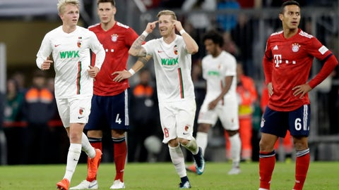 <p>               Augsburg's Felix Goetze, left, watches his team mates after scoring his side's opening goal during the German Bundesliga soccer match between FC Bayern Munich and FC Augsburg in Munich, Germany, Tuesday, Sept. 25, 2018. (AP Photo/Matthias Schrader)             </p>