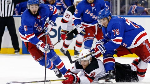 <p>               New Jersey Devils' Taylor Hall (9) battles for the puck between New York Rangers' Brady Skjei (76) and Mika Zibanejad (93) in the third period of a preseason NHL hockey game Monday, Sept. 24, 2018, in New York. (AP Photo/Adam Hunger)             </p>