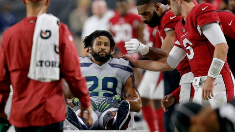 <p>               Seattle Seahawks defensive back Earl Thomas (29) is greeted by Arizona Cardinals players as he leaves the field after breaking his leg during the second half of an NFL football game, Sunday, Sept. 30, 2018, in Glendale, Ariz. The Seahawks won 20-17. (AP Photo/Ross D. Franklin)             </p>