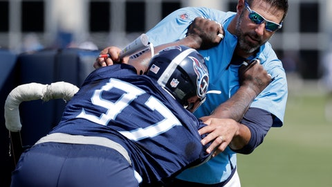 <p>               FILE - In this July 26, 2018, file photo, Tennessee Titans head coach Mike Vrabel runs a drill with defensive end Claude Pelon (97) during NFL football training camp in Nashville, Tenn. Vrabel has shown himself to be a hands' on coach with a sense of humor all while determined to run the Tennessee Titans his way. Now the first-time head coach faces his NFL debut Sunday in Miami where a victory sure would help erase thoughts of a winless preseason. (AP Photo/Mark Humphrey)             </p>