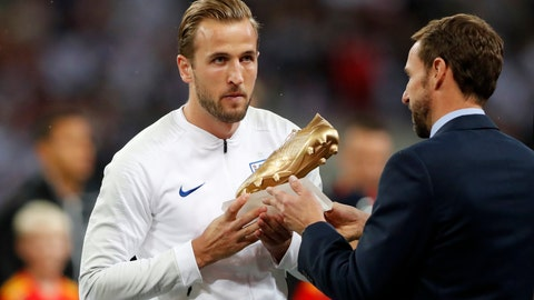 <p>               England manager Gareth Southgate hands England's Harry Kane his World Cup Golden Boot before the UEFA Nations League soccer match between England and Spain at Wembley stadium in London, Saturday Sept. 8, 2018. (AP Photo/Frank Augstein)             </p>