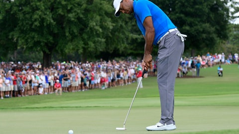 <p>               Tiger Woods putts for birdie on the third hole during the third round of the Tour Championship golf tournament Saturday, Sept. 22, 2018, in Atlanta. (AP Photo/John Amis)             </p>