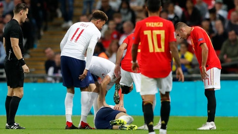 <p>               The players look at England's Luke Shaw on the ground after he injured himself during the UEFA Nations League soccer match between England and Spain at Wembley stadium in London, Saturday Sept. 8, 2018. (AP Photo/Frank Augstein)             </p>