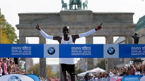 <p>               Eliud Kipchoge runs to win the 45th Berlin Marathon in Berlin, Germany, Sunday, Sept. 16, 2018. Eliud Kipchoge set a new world record in 2 hours 1 minute 40 seconds. (AP Photo/Michael Sohn)             </p>