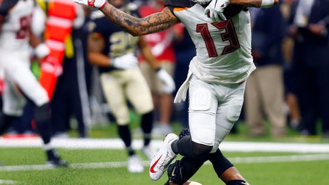 <p>               Tampa Bay Buccaneers wide receiver Mike Evans (13) carries against New Orleans Saints cornerback Marshon Lattimore (23) in the second half of an NFL football game in New Orleans, Sunday, Sept. 9, 2018. (AP Photo/Butch Dill)             </p>