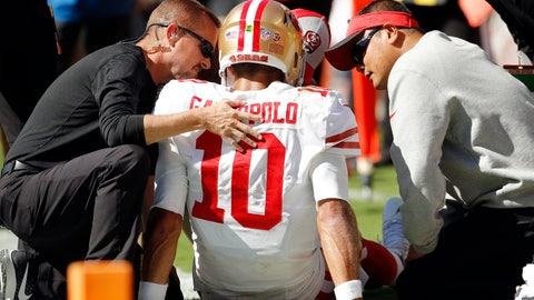 <p>               Trainers attend to San Francisco 49ers quarterback Jimmy Garoppolo (10) who was injured after a tackle by Kansas City Chiefs defensive back Steven Nelson during the second half of an NFL football game in Kansas City, Mo., Sunday, Sept. 23, 2018. (AP Photo/Charlie Riedel)             </p>