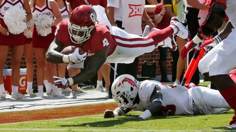 <p>               Oklahoma running back Trey Sermon (4) dives over Florida Atlantic safety James Pierre (23) for a touchdown in the first half of an NCAA college football game in Norman, Okla., Saturday, Sept. 1, 2018. (AP Photo/Sue Ogrocki)             </p>
