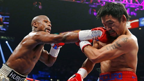 <p>               FILE - In this May 2, 2015, file photo, Floyd Mayweather Jr., left, connects with a right to the head of Manny Pacquiao, from the Philippines, during their welterweight title fight in Las Vegas. Mayweather Jr. says he's coming out of retirement again to fight Pacquiao for a second time in December. Mayweather posted a video on Instagram early Saturday, ept. 15, 2018, that showed Pacquiao and him together, reportedly in Japan, jawing at each other over a possible second fight. Representatives for the two fighters could not immediately be reached for comment. (AP Photo/John Locher, File)             </p>