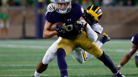 <p>               FILE - In this Sept. 1, 2018, file photo, Notre Dame wide receiver Chris Finke (10) is brought down by Michigan linebacker Khaleke Hudson in the first half of an NCAA college football game in South Bend, Ind. Finke is eager to help. The former preferred walk-on from Dayton, Ohio, had zero scholarship offers coming out of high school.  He established himself as a contributor, earning a scholarship his sophomore year and became the team's punt returner and an option at receiver. Now in his senior season, Finke knows he can provide leadership and set an example for his younger teammates. (AP Photo/Paul Sancya, File)             </p>