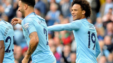 <p>               Manchester City's Leroy Sane, right, celebrates after scoring his side's first goal during the English Premier League soccer match between Manchester City and Fulham at Etihad stadium in Manchester, England, Saturday, Sept. 15, 2018. (AP Photo/Rui Vieira)             </p>