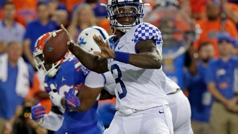 <p>               Kentucky quarterback Terry Wilson (3) looks for a receiver as he is pressured by the Florida defense during the first half of an NCAA college football game, Saturday, Sept. 8, 2018, in Gainesville, Fla. (AP Photo/John Raoux)             </p>