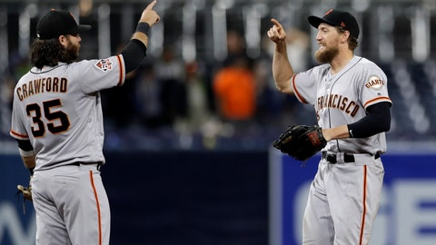 <p>               San Francisco Giants right fielder Hunter Pence, right, and shortstop Brandon Crawford (35) celebrate after the Giants defeated the San Diego Padres 5-4 in a baseball game Tuesday, Sept. 18, 2018, in San Diego. (AP Photo/Gregory Bull)             </p>