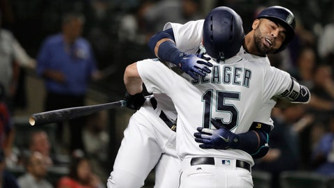 <p>               Seattle Mariners' Nelson Cruz, right, hugs Kyle Seager (15) after Cruz hit a solo home run during the fifth inning of a baseball game against the Baltimore Orioles, Wednesday, Sept. 5, 2018, in Seattle. The homer was back-to-back with one hit by Mariners' Denard Span. (AP Photo/Ted S. Warren)             </p>