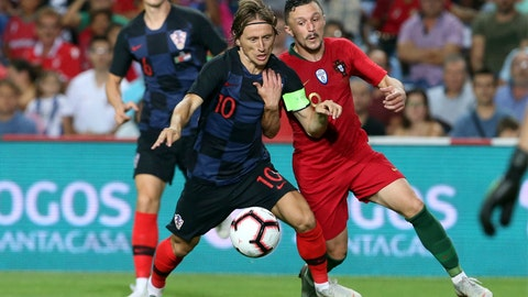 <p>               Croatia's Luka Modric fights for the ball with Portugal's Mario Rui, right, during the international friendly soccer match between Portugal and Croatia at the Algarve stadium, outside Faro, Portugal, Thursday, Sept. 6, 2018. (AP Photo/Armando Franca)             </p>