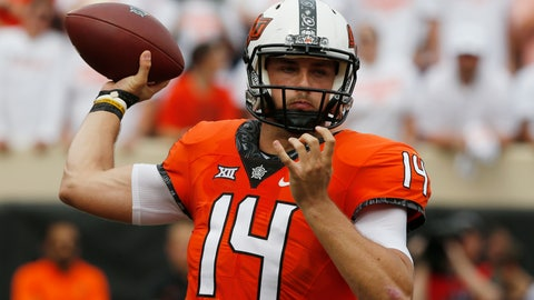 <p>               Oklahoma State quarterback Taylor Cornelius (14) throws in the first half of an NCAA college football game against Boise State in Stillwater, Okla., Saturday, Sept. 15, 2018. (AP Photo/Sue Ogrocki)             </p>