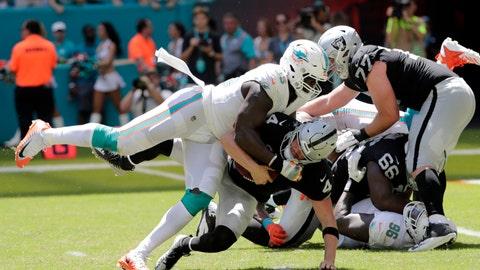 <p>               Miami Dolphins defensive end William Hayes (95) sacks Oakland Raiders quarterback Derek Carr (4) during the first half of an NFL football game, Sunday, Sept. 23, 2018 in Miami Gardens, Fla. (AP Photo/Lynne Sladky)             </p>