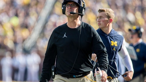 <p>               Michigan head coach Jim Harbaugh walks the sideline looking up at the scoreboard in the second quarter of an NCAA college football game against SMU in Ann Arbor, Mich., Saturday, Sept. 15, 2018. (AP Photo/Tony Ding)             </p>