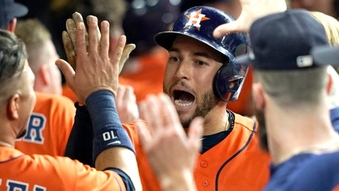 <p>               Houston Astros' George Springer celebrates in the dugout after hitting a three-run home run against the Los Angeles Angels during the eighth inning of a baseball game Friday, Sept. 21, 2018, in Houston. (AP Photo/David J. Phillip)             </p>