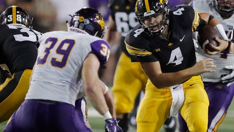 <p>               Iowa quarterback Nate Stanley (4) runs from Northern Iowa linebacker Duncan Ferch (39) during the second half of an NCAA college football game, Saturday, Sept. 15, 2018, in Iowa City, Iowa. (AP Photo/Charlie Neibergall)             </p>