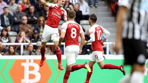 <p>               Arsenal's Granit Xhaka, left, celebrates scoring his side's first goal of the game with teammates, during the English Premier League soccer match between Newcastle United and Arsenal at St James' Park, in Newcastle, England, Saturday, Sept. 15, 2018. (Owen Humphreys/PA via AP)             </p>