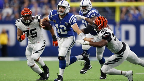 <p>               Indianapolis Colts quarterback Andrew Luck (12) is chased by Cincinnati Bengals defensive end Jordan Willis (75) and defensive end Michael Johnson (90) during the second half of an NFL football game in Indianapolis, Sunday, Sept. 9, 2018. The Bengals defeated the Colts 34-23. (AP Photo/Jeff Roberson)             </p>