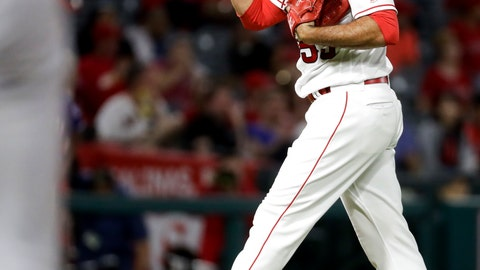 <p>               Los Angeles Angels relief pitcher Blake Parker reacts after giving up the first hit of the game to the Texas Rangers during the eighth inning of a baseball game in Anaheim, Calif., Tuesday, Sept. 11, 2018. (AP Photo/Chris Carlson)             </p>