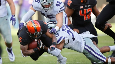 <p>               FILE - In this Nov. 18, 2017, file photo, Oklahoma State running back Justice Hill (5) is tackled by Kansas State defensive back Cre Moore (23) and linebacker Jayd Kirby (46) during the first half of an NCAA college football game in Stillwater, Okla. Kansas State, which has had one of the top rushing defenses in the nation each of the two seasons, plays Mississippi State this week. (AP Photo/Sue Ogrocki, File)             </p>
