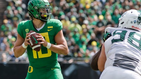 <p>               Oregon quarterback Justin Herbert (10) looks for a receiver that will catch his touchdown pass against Portland State during an NCAA college football game in Eugene, Ore., Saturday, Sept. 8, 2018. (AP Photo/Thomas Boyd)             </p>