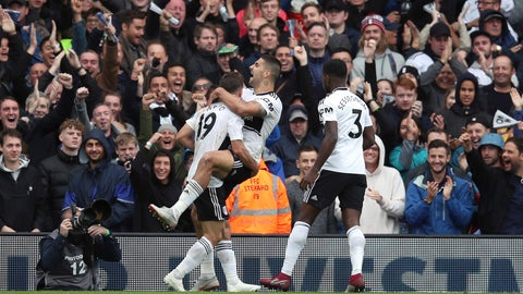 <p>               Fulham's Aleksandar Mitrovic, centre, celebrates scoring his side's first goal of the game against Watford during their English Premier League soccer match at Craven Cottage in London, Saturday Sept. 22, 2018. (Chris Radburn/PA via AP)             </p>