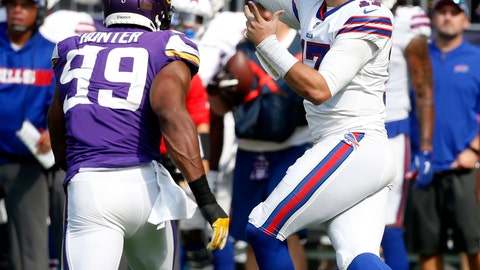 <p>               Buffalo Bills quarterback Josh Allen throws a pass over Minnesota Vikings defensive end Danielle Hunter (99) during the first half of an NFL football game, Sunday, Sept. 23, 2018, in Minneapolis. (AP Photo/Bruce Kluckhohn)             </p>