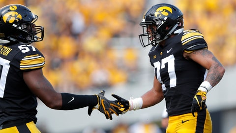 <p>               Iowa defensive back Amani Hooker, right, celebrates with teammate Chauncey Golston after intercepting a pass during the first half of an NCAA college football game against Northern Illinois, Saturday, Sept. 1, 2018, in Iowa City, Iowa. (AP Photo/Charlie Neibergall)             </p>
