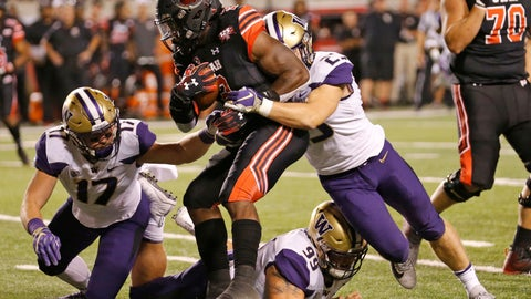 <p>               Utah running back Zack Moss (2) is tackled by Washington's Ben Burr-Kirven (25), Greg Gaines (99) and Tevis Bartlett (17) in the first half during an NCAA college football game, Saturday, Sept. 15, 2018, in Salt Lake City. (AP Photo/Rick Bowmer)             </p>