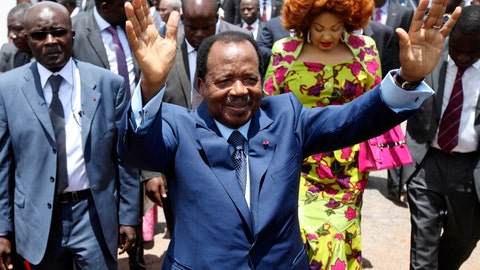 <p>               FILE - In this Sunday Oct 9, 2011 file photo, Cameroon President Paul Biya waves after casting his vote during the presidential elections in Yaounde, Cameroon. A bloody conflict between Cameroon's government and Anglophone separatists over language is now threatening next month's presidential election. The 85-year-old President Paul Biya, one of Africa's longest-serving leaders, vows to hold the largely Francophone country together even as thousands flee violence in English-speaking regions. (AP Photo/Sunday Alamba, File)             </p>