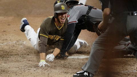 <p>               San Diego Padres' Javy Guerra scores the winning run off a double by Freddy Galvis during the fifteenth inning of a baseball game against the Arizona Diamondbacks Saturday, Sept. 29, 2018, in San Diego. (AP Photo/Gregory Bull)             </p>