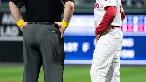 <p>               Umpire Joe West, left, talks with Philadelphia Phillies manager Gabe Kapler, right, about the situation with relief pitcher Austin Davis during the eighth inning of a baseball game against the Chicago Cubs, Saturday, Sept. 1, 2018, in Philadelphia. West confiscated a card from Davis. Davis and Phillies manager Gabe Kapler said he was using the card merely for information on the Cubs hitters. But West said it was illegal under Rule 6.02(c)(7), which states that the pitcher shall not have on his person, or in his possession, any foreign substance. The Cubs won 7-1. (AP Photo/Chris Szagola)             </p>