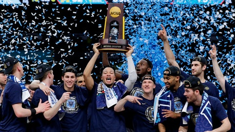 """<p>               FILE - In thisMonday, April 2, 2018 file photo, Villanova players celebrate with the trophy after beating Michigan 79-62 in the championship game of the Final Four NCAA college basketball tournament in San Antonio. Under Construction: The finishing touches on the $60-plus million renovation of Villanova's on-campus home and the national champions that will call it home. The Wildcats are certainly there among the elite after winning two national championships in three seasons, their basketball blood now as blue as the """"V"""" in their logo, reeling off 30-win seasons that's sent the 2019 forecast again sky high.  (AP Photo/David J. Phillip, File)             </p>"""