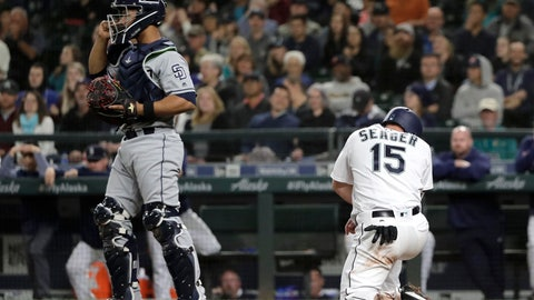 <p>               Seattle Mariners' Kyle Seager kneels at the plate after he was tagged out at home by San Diego Padres catcher Francisco Mejia, left, on a fielders choice play during the seventh inning of a baseball game, Tuesday, Sept. 11, 2018, in Seattle. (AP Photo/Ted S. Warren)             </p>