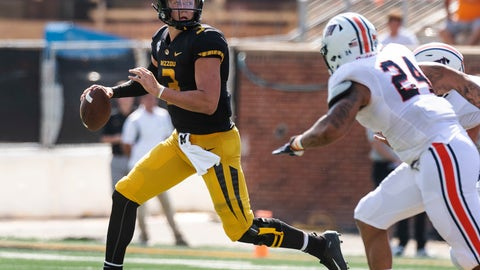 <p>               Missouri quarterback Drew Lock, left, is chased out of the pocket by Tennessee-Martin's Loren Young, right, during the first half of an NCAA college football game Saturday, Sept. 1, 2018, in Columbia, Mo. (AP Photo/L.G. Patterson)             </p>