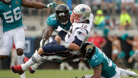 <p>               FILE - In this Sept. 16, 2018, file photo, New England Patriots quarterback Tom Brady (12) is tackled by Jacksonville Jaguars defensive tackle Malik Jackson (97) and defensive back A.J. Bouye (21) after scrambling for yardage during the second half of an NFL football game, in Jacksonville, Fla. The Jacksonville Jaguars, who ranked second in the NFL with 55 sacks in 2017, have four in two games _ on pace for 32 this season. Jacksonville hopes to end the trend against AFC South rival Tennessee on Sunday.(AP Photo/Phelan M. Ebenhack, File)             </p>