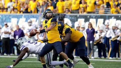 <p>               West Virginia quarterback Will Grier (7) pass the ball during the first half of an NCAA college football game against Kansas State Saturday, Sept.22, 2018, in Morgantown, W.Va. (AP Photo/Raymond Thompson)             </p>