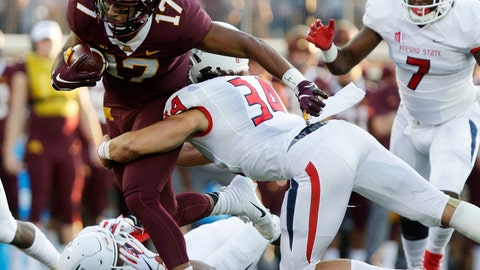 <p>               Minnesota wide receiver Seth Green (17) is tackled by Fresno State defensive players George Helmuth (34), James Bailey (7) and Juju Hughes (23) in the first quarter of an NCAA college football game, Saturday, Sept. 8, 2018, in Minneapolis. (AP Photo/Andy Clayton-King)             </p>