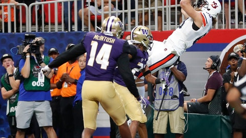 <p>               Auburn tight end Sal Cannella (80) makes a catch for a touchdown as Washington defensive backs Jordan Miller (23) and JoJo McIntosh (14) defend in the first half of an NCAA college football game Saturday, Sept. 1, 2018, in Atlanta. (AP Photo/John Bazemore)             </p>