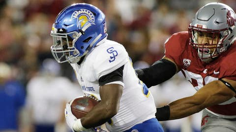 <p>               San Jose State running back Malike Roberson, left, avoids a tackle by Washington State defensive lineman Nnamdi Oguayo during the first half of an NCAA college football game in Pullman, Wash., Saturday, Sept. 8, 2018. (AP Photo/Young Kwak)             </p>