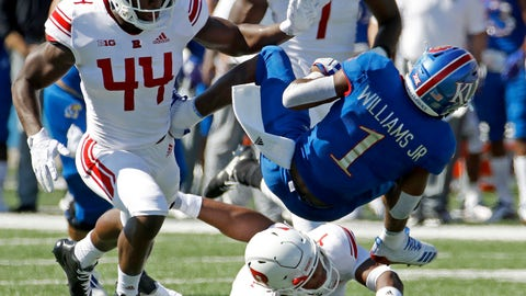 <p>               Kansas running back Pooka Williams Jr. (1) is tackled by Rutgers linebacker Tyreek Maddox-Williams (44) during the first half of an NCAA college football game Saturday, Sept. 15, 2018, in Lawrence, Kan. (AP Photo/Charlie Riedel)             </p>