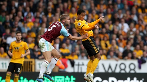 <p>               Burnley's Charlie Taylor, left, and Wolverhampton Wanderers' Helder Costa jump for an aerial ball during their English Premier League soccer match at Molineux stadium in Wolverhampton, Sunday Sept. 16, 2018. (Nick Potts/PA via AP)             </p>