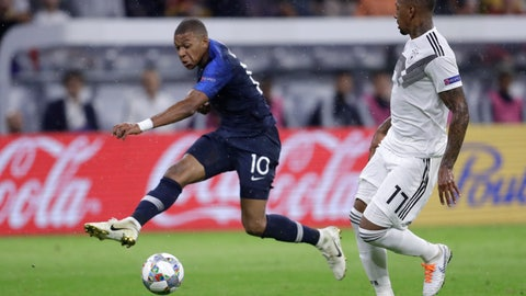 <p>               France's Kylian Mbappe, left, shoots past Germany's Jerome Boateng during the UEFA Nations League soccer match between Germany and France in Munich, Germany, Thursday, Sept. 6, 2018. (AP Photo/Michael Probst)             </p>