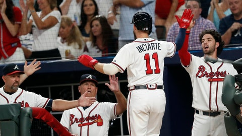 <p>               Atlanta Braves from left; bench coach Walt Weiss, manager Brian Snitker, and shortstop Dansby Swanson greet Ender Inciarte (11) at the dugout after scoring on a Atlanta Braves right fielder Nick Markakis base hit in the first inning of a baseball game against the Philadelphia Phillies Thursday, Sept. 20, 2018, in Atlanta. (AP Photo/John Bazemore)             </p>