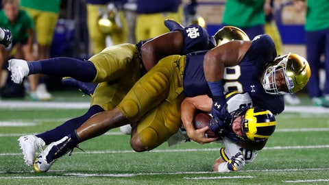 <p>               Notre Dame defensive lineman Jerry Tillery (99) tackles Michigan quarterback Dylan McCaffrey (10) in the second half of an NCAA football game in South Bend, Ind., Saturday, Sept. 1, 2018. Notre Dame won 24-17. (AP Photo/Paul Sancya)             </p>