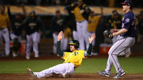 <p>               Oakland Athletics' Stephen Piscotty slides to score in front of Minnesota Twins' Trevor Hildenberger in the ninth inning of a baseball game Saturday, Sept. 22, 2018, in Oakland, Calif. Piscotty scored on a walk-off wild pitch by Hildenberger. (AP Photo/Ben Margot)             </p>