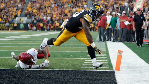 <p>               Iowa running back Mekhi Sargent, right, slips out of the hands of Iowa State defensive back D'Andre Payne, left, to score a touchdown during the second half of an NCAA college football game, Saturday, Sept. 8, 2018, in Iowa City, Iowa. Iowa won 13-3. (AP Photo/Matthew Putney)             </p>